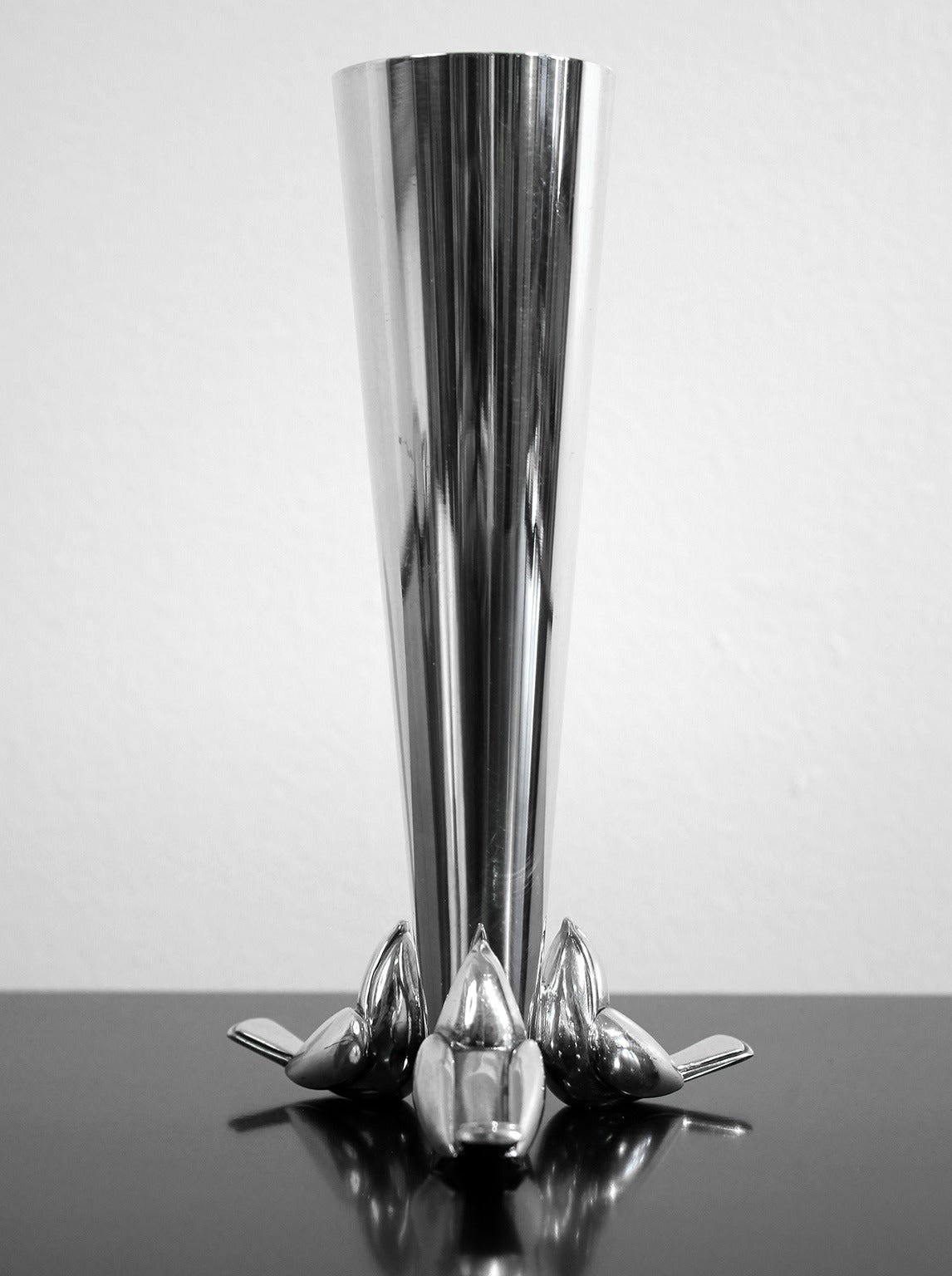 Silver plated bud vase with a trio of stylized bird figures at the base by Christofle.