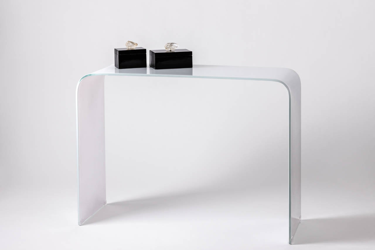 Opaque white waterfall glass console for sale at stdibs