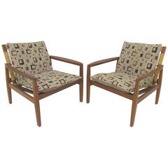 Pair of Danish Teak and Cane Lounge Chairs by Hans Olsen