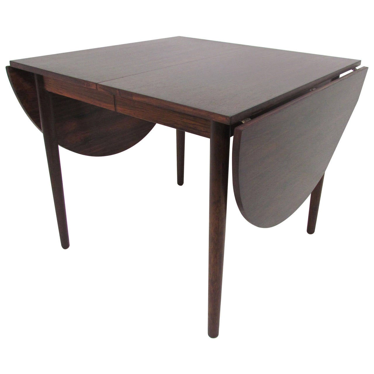 Drop leaf expandable danish rosewood dining table by arne for Expandable dining table