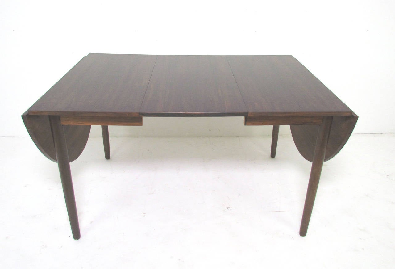 drop leaf expandable danish rosewood dining table by arne vodder image