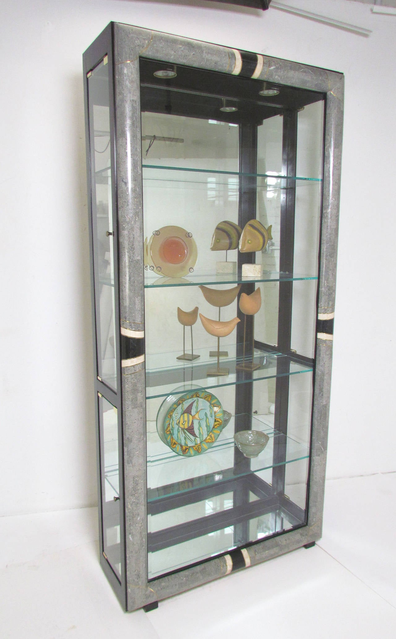 Lighted vitrine display cabinet in tessellated fossil for Sideboard vitrine