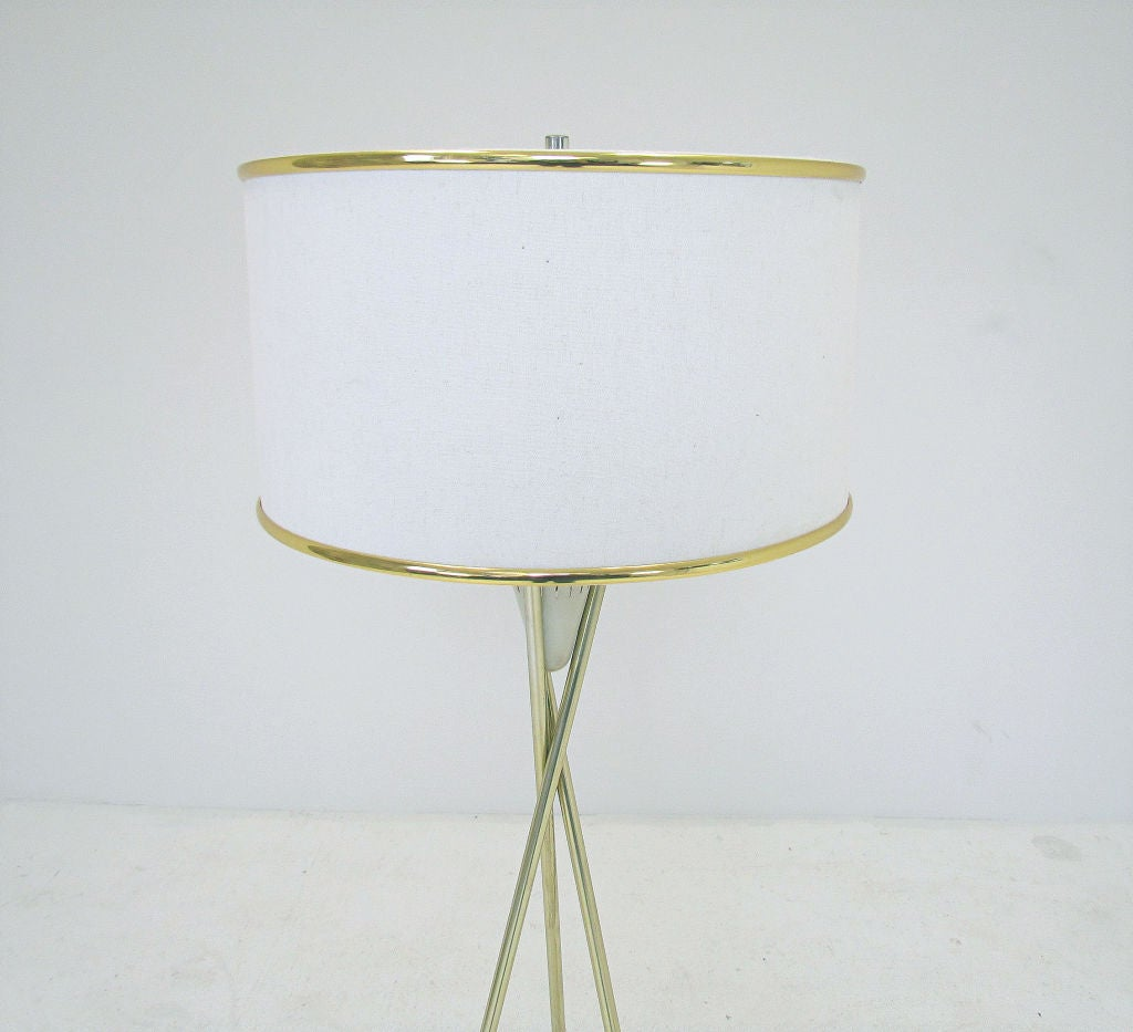 Tripod floor lamp in brass with walnut capped legs, ca. 1960s, attributed to Gerald Thurston for Lightolier.