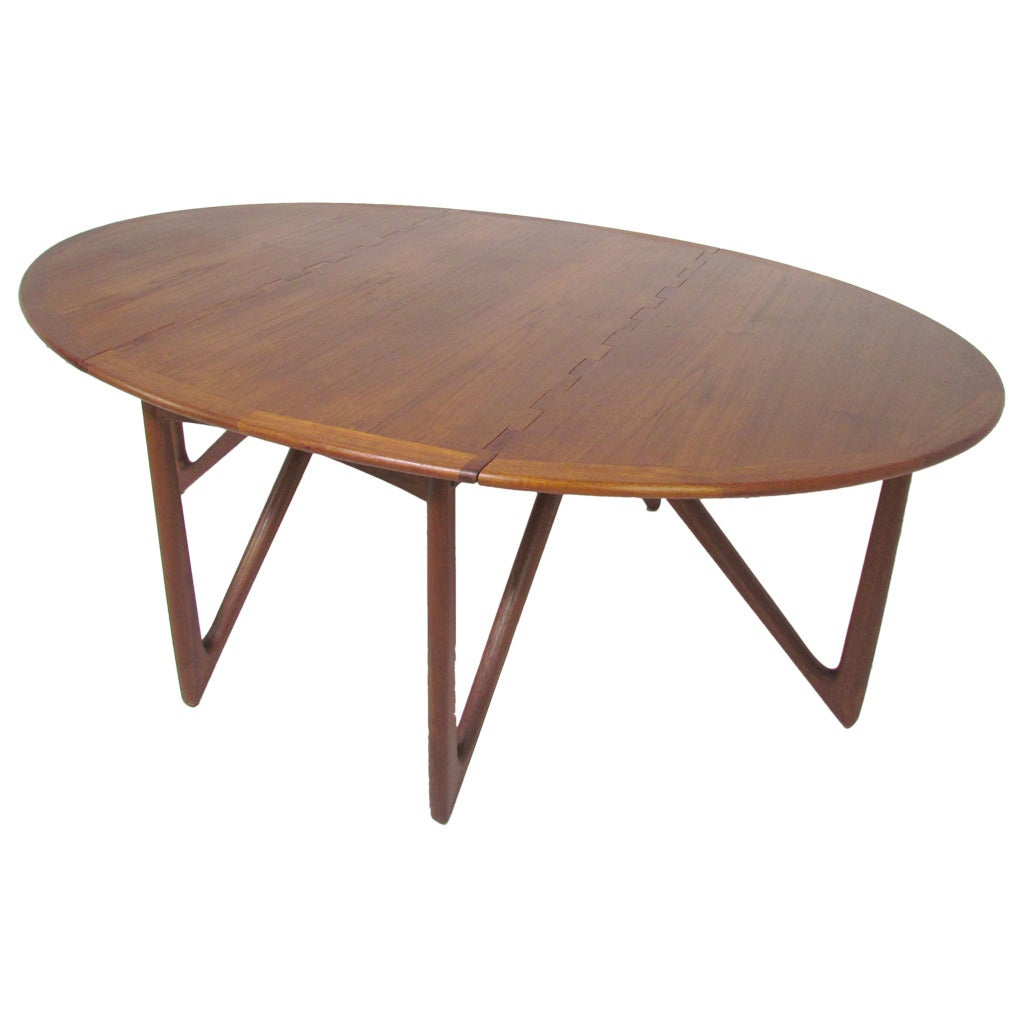 Danish teak gate leg drop leaf oval dining table by kurt for Circle dining room table with leaf