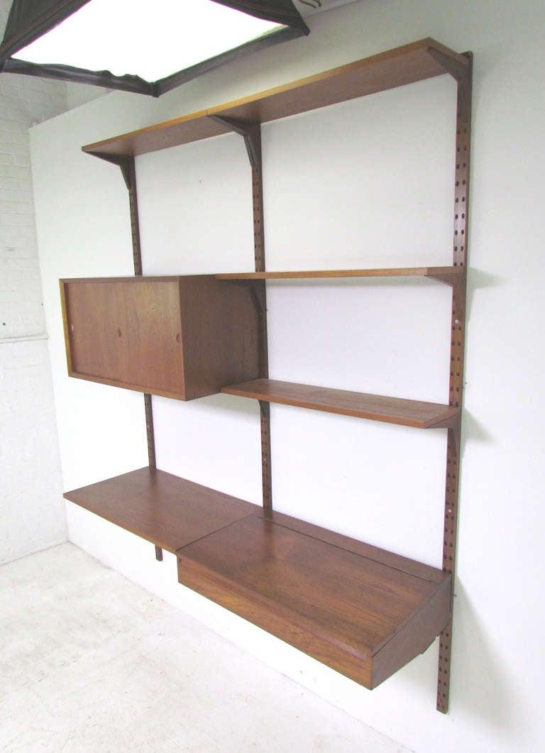 danish teak wall mounted shelving unit by poul cadovius. Black Bedroom Furniture Sets. Home Design Ideas