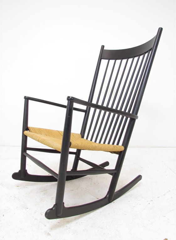 """Hans Wegner """"J16"""" rocker with corded seat for FDB Mobler, Denmark.  Created in 1944, this has been one of Wegner's most widely recognized designs.  This vintage rocking chair marked with production date of 1972."""