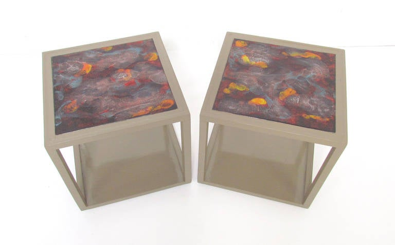 Pair of cube-form end tables with Italian tile tops by Edward Wormley for Drexel's Precedent line.   The tile tops feature an abstract painterly glaze.