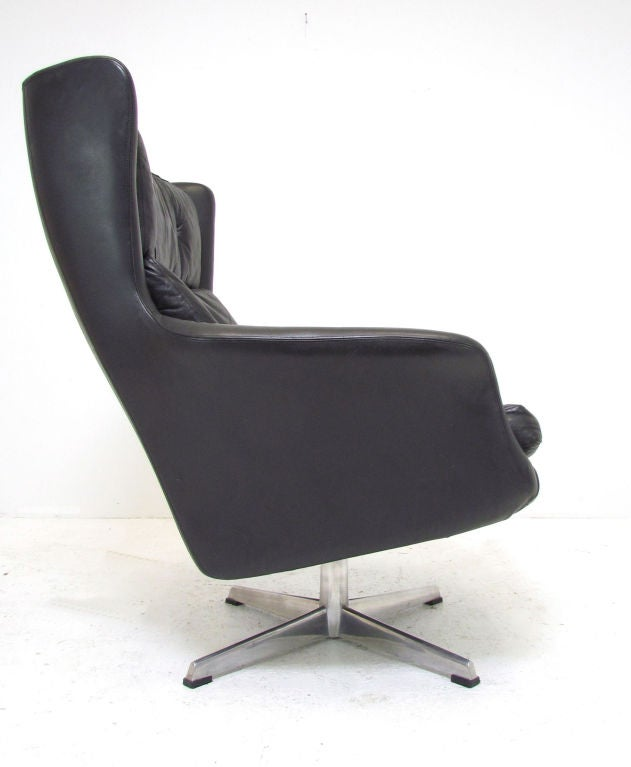 this danish leather high back swivel lounge chair ca 1970s is no