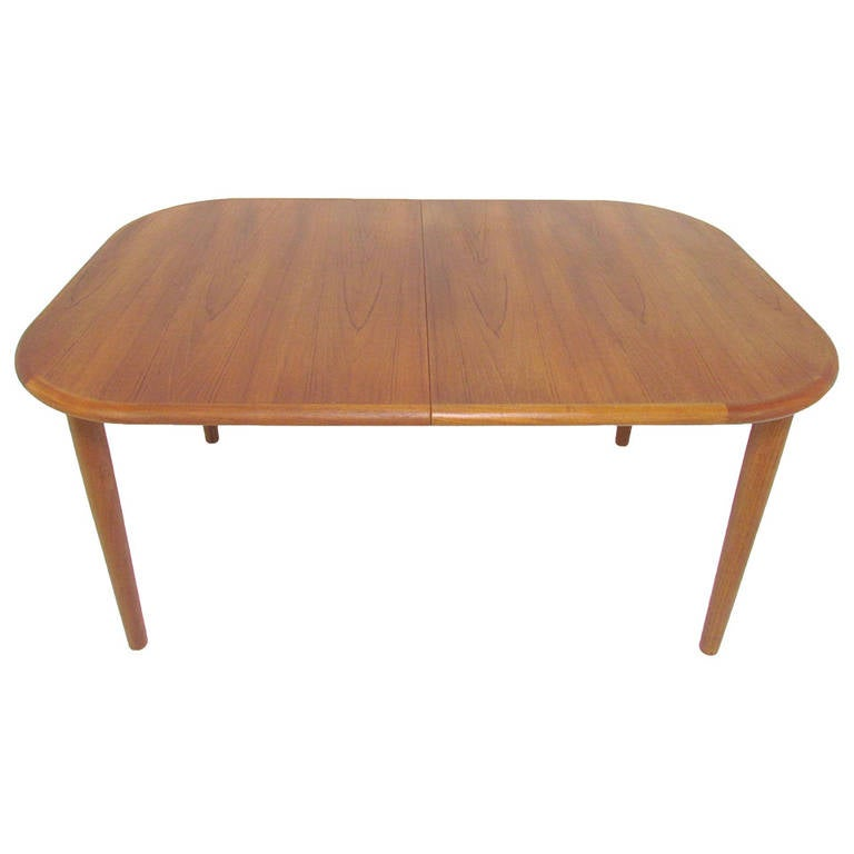 this danish teak oval dining table with butterfly extension leaf is no