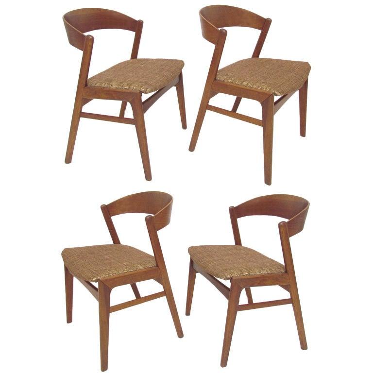 set of four ribbon back modern teak dining chairs