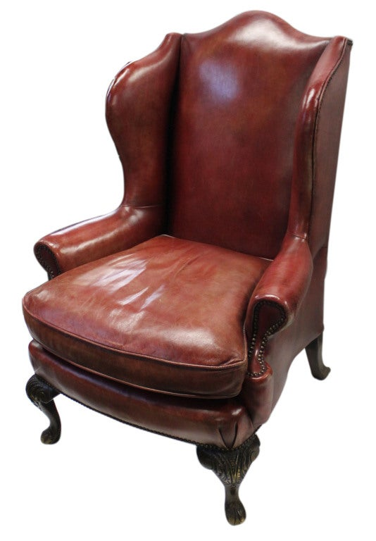English Red Leather Wingback Chair With Hand Carved Legs And Nailhead Trim Detail Throughout