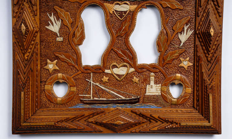Fine nautical themed tramp art frame with relief carvings