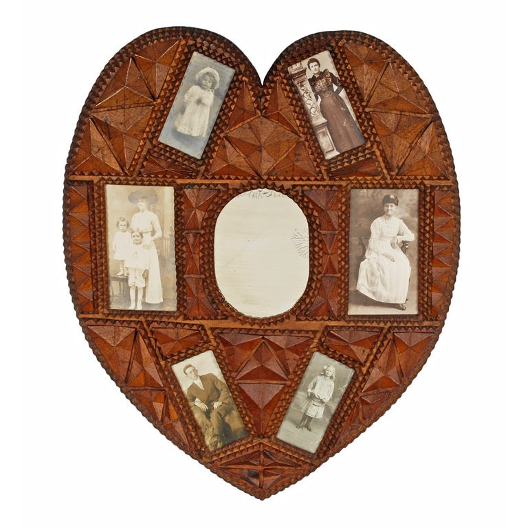 Fine heart shaped tramp art portrait frame with central for Types of mirror frames