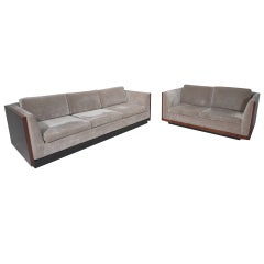 A set of Milo Baughman silver velvet sofas with Rosewood cases