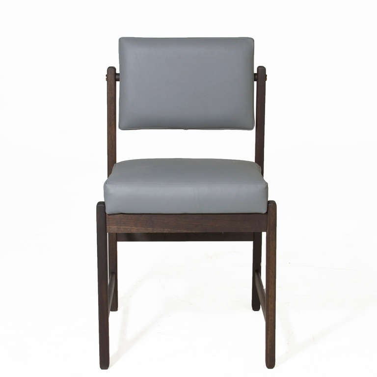 basic pivot back dining chair in solid walnut and charcoal oil finish