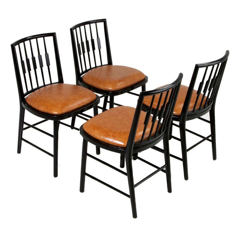 set of four black spindle back dining chairs by baker for