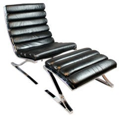 Tufted black leather and chromed chair by Design Institute