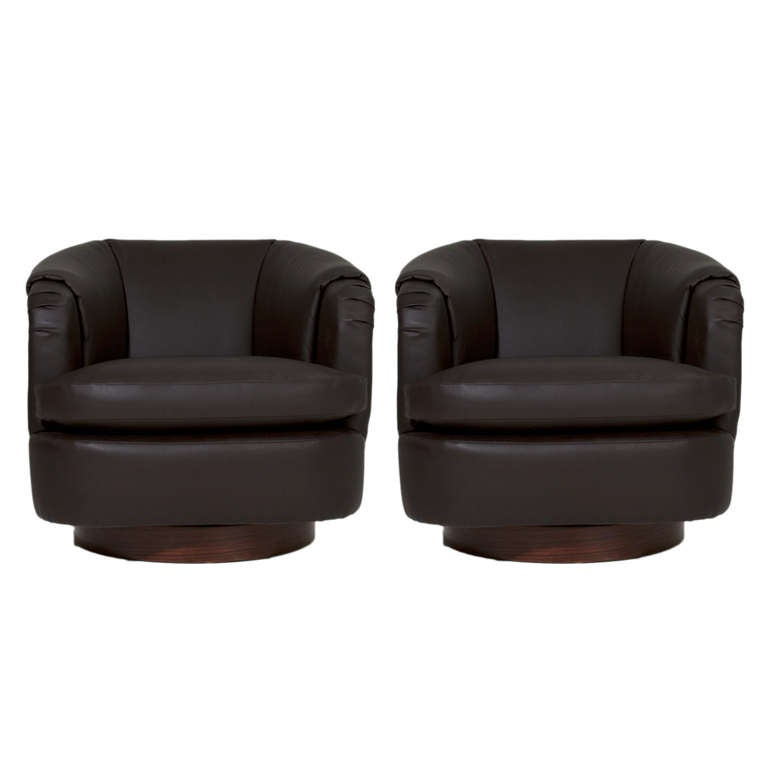 Pair of brown leather club armchairs with rosewood swivel for Swivel club chair leather
