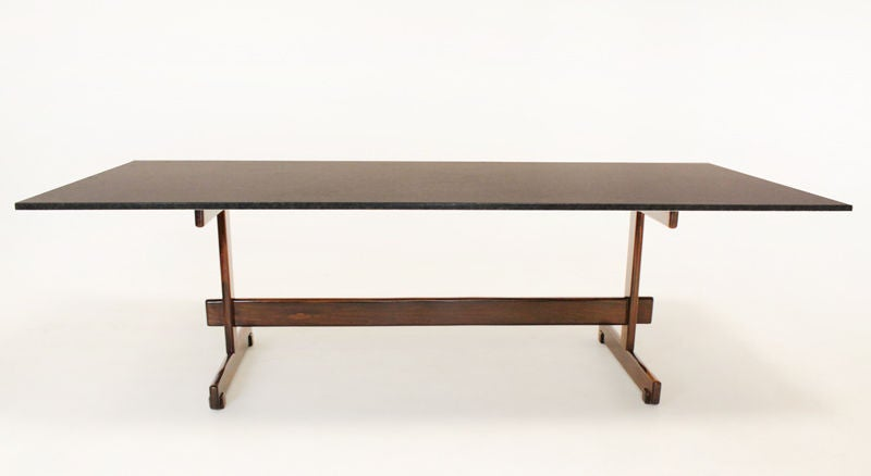this sergio rodrigues solid rosewood and granite dining table is no