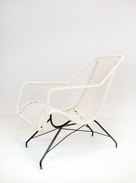 A comfortable pair of iron frame lounge chairs designed by Brazil's Martin Eisler with cord wrapped seats, back and arms. A similar pair of chairs is also available: http://www.1stdibs.com/furniture_item_detail.php?id=527615  Seat depth measures