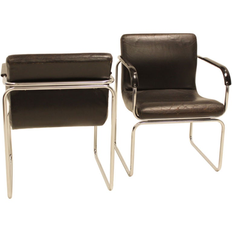 pair of vintage black leather tubular chrome side chairs