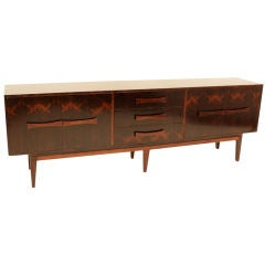 A narrow rosewood credenza with horizontal rosewood handles