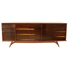 Rosewood cabinet with angled drawers and vintage brass pulls