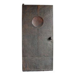 Hand-hammered heavy copper door Forms and Surfaces attribution
