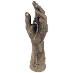 A cast bronze hand sculpture