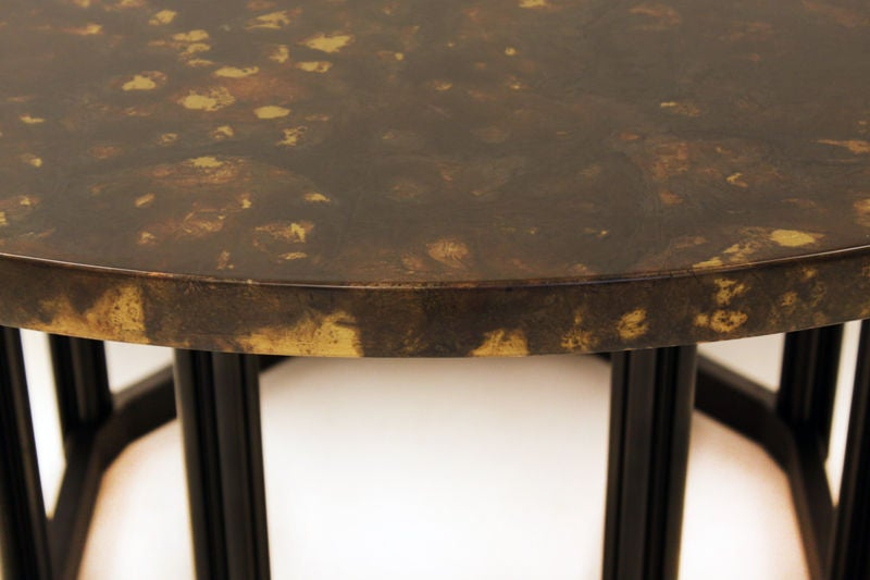 round dining table with patinated metal top at 1stdibs