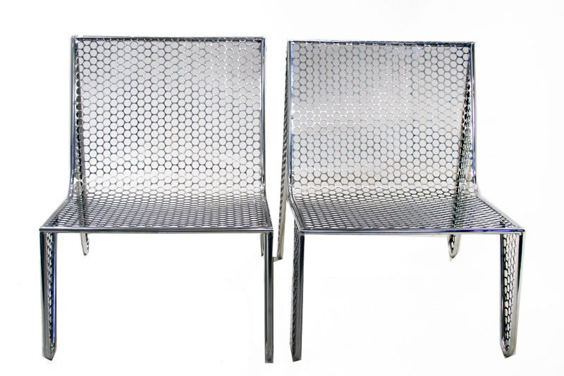 """A stunning set of four """"Inox"""" chairs by young Brazilian designer Zanini de Zanine, made from polished stainless steel sheets salvaged after Brazilian coins were cut out from them. Each hole has been hand worked to be free of any burrs or snags. Inox"""