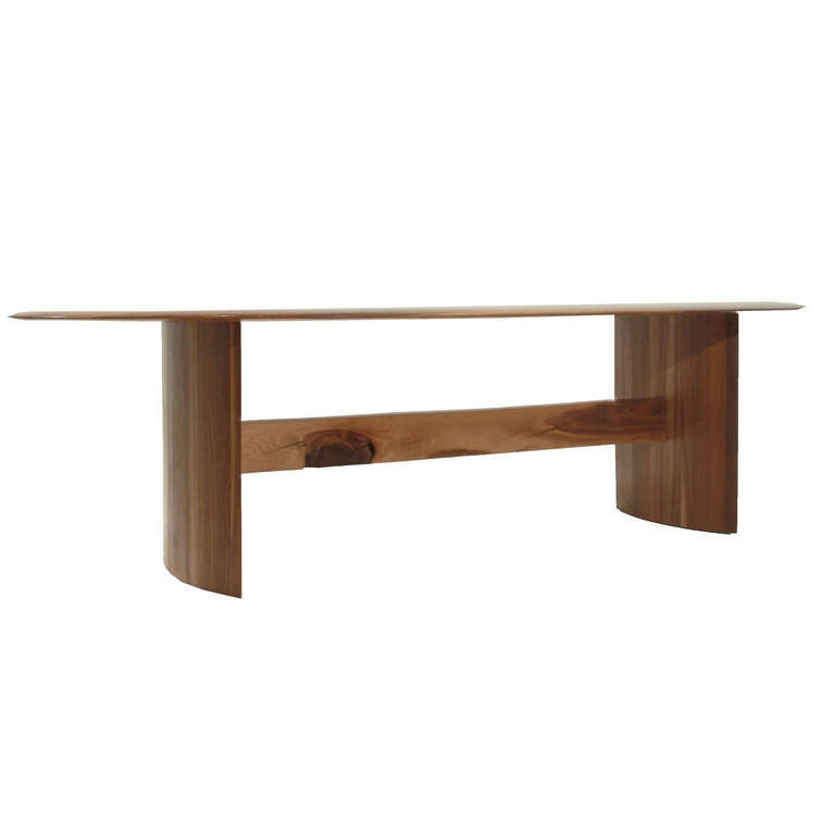 The jantar ellipse dining table in walnut by thomas hayes studio image