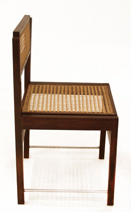 set of six brazilian hardwood swivel back dining chairs with caned