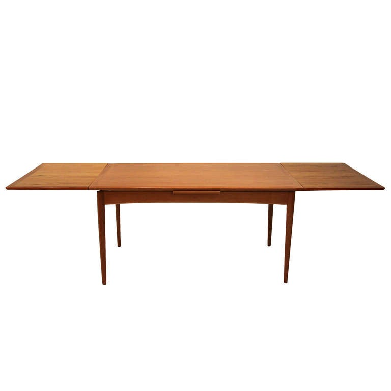 Teak Selig Dining Table With Two Leafs at 1stdibs : Extendeddiningtable01l from www.1stdibs.com size 768 x 768 jpeg 13kB