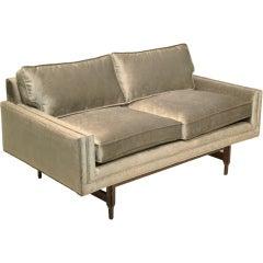 California design walnut based love seat with silk-bronze fabric