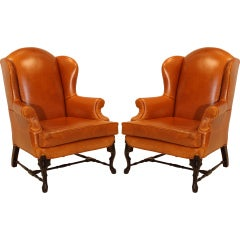 Pair of Leather Wing Back Chairs with Solid Sculptural Feet