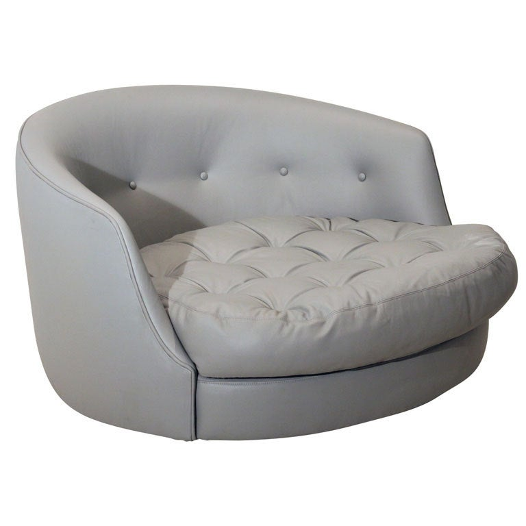 Large round gray leather swivel love chair by Milo Baughman