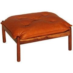 Solid Caviuna ottoman with tufted cushion