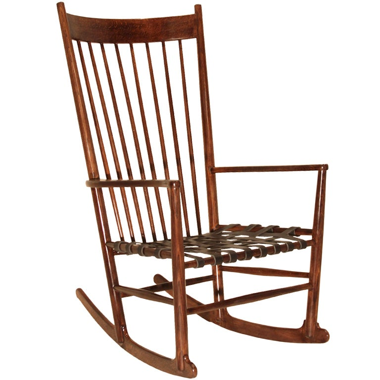 Hans Wegner rocking chair with black leather strap seat at 1stdibs