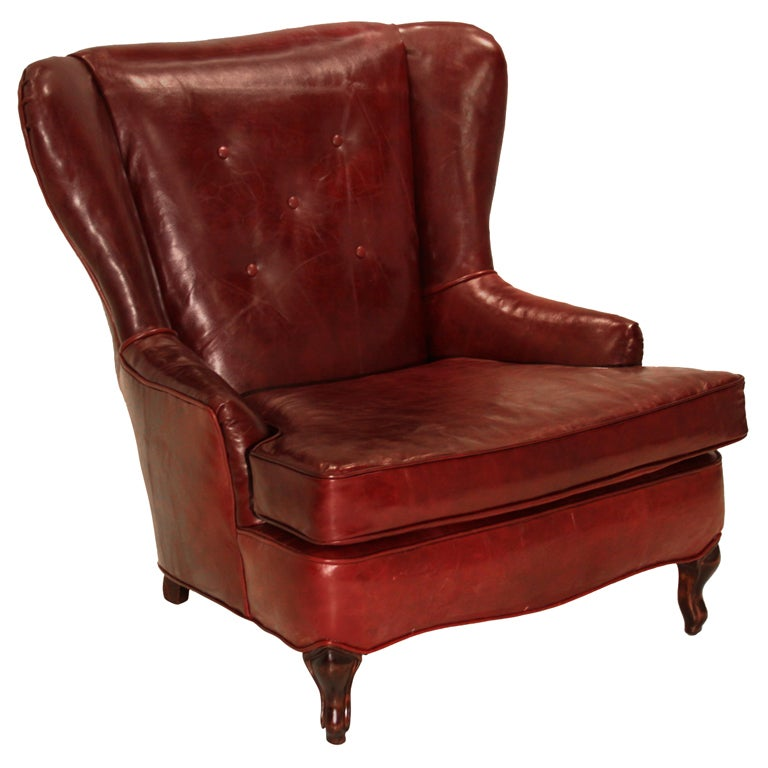 Obtuse oxblood leather and walnut wing back chair for sale at 1stdibs