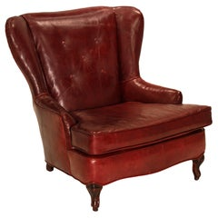 Obtuse oxblood leather and Walnut wing back chair