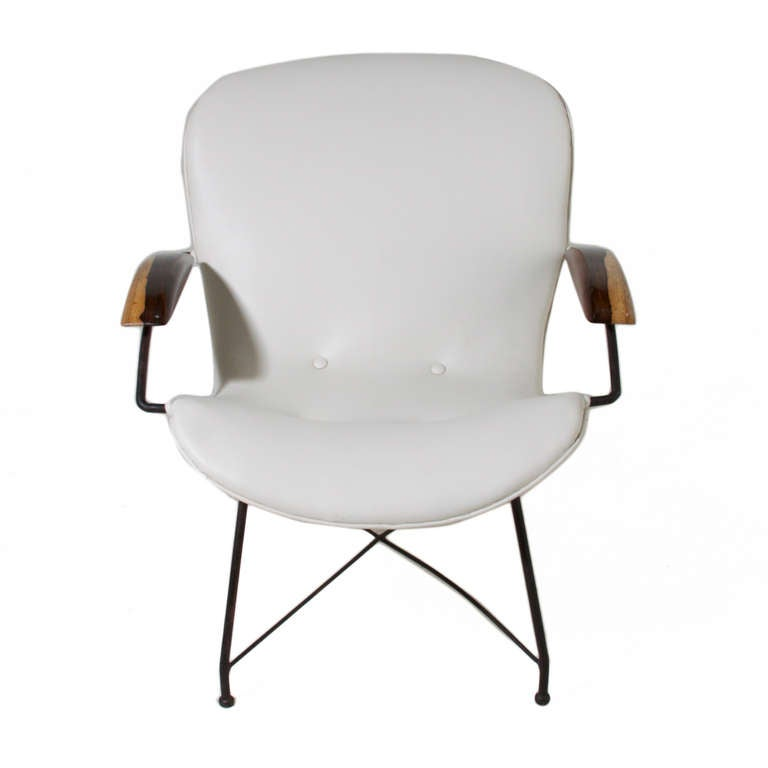 Martin eisler leatherette iron and rosewood arm chair at