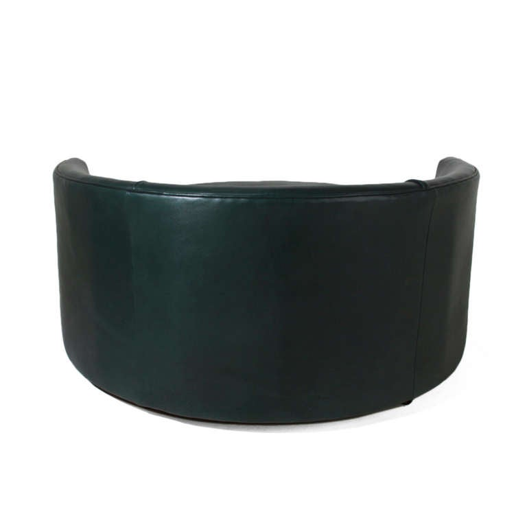 round green leather swivel love chair by Milo