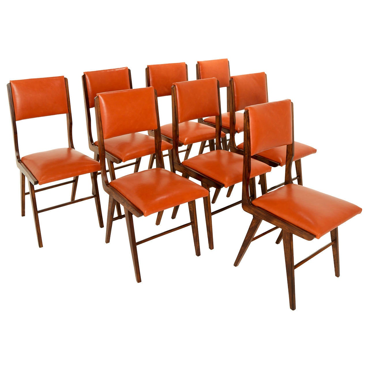 Eight Brazilian Rosewood And Leather Dining Chairs