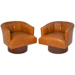 Pair Of Caramel Leather And Rosewood Swivel Chairs