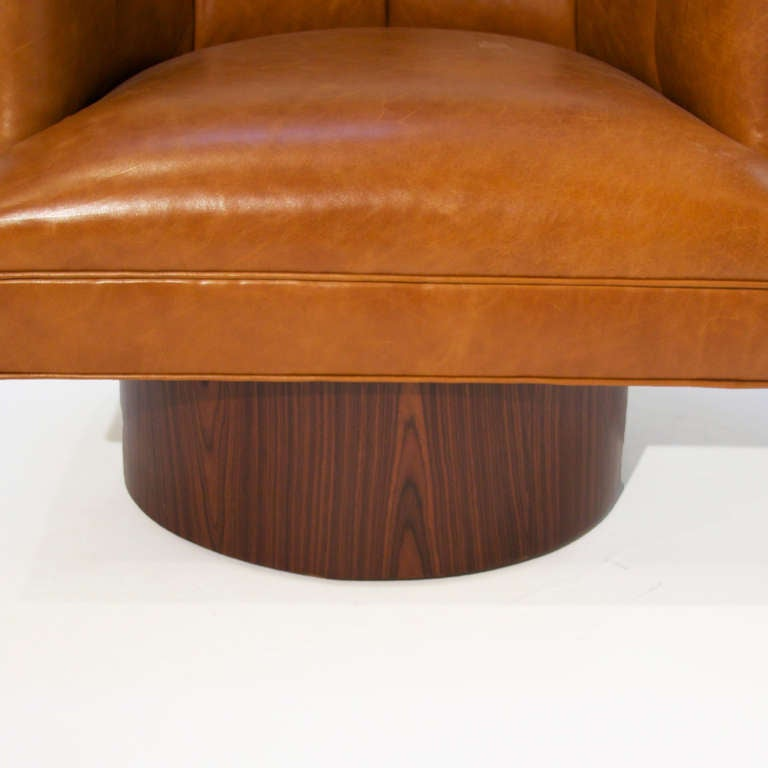 Pair Of Caramel Leather And Rosewood Swivel Chairs At 1stdibs