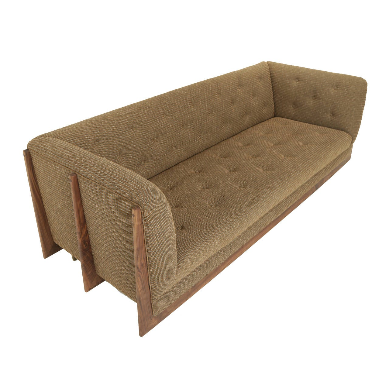 A custom sofa with three extruded solid wood spines that support the case on either end on top of cylindrical solid bronze feet. The upholstery is tufted but can also be done with loose cushions.   This exact sofa is available immediately, but it