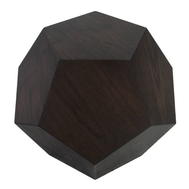 The Dodecahedron side table by Thomas Hayes Studio. The geometric design features 12 pentagons seamlessly attached to one another to form the three dimensional dodecahedron.  This item is available for custom order and the lead time is 6-8 weeks;