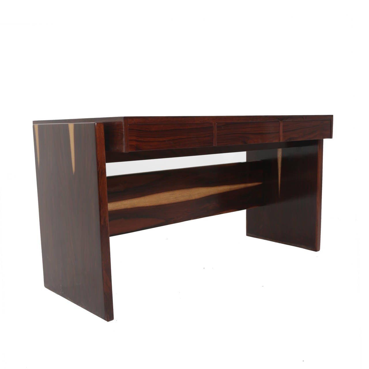Rosewood desk designed by Brazil's Joaquim Tenreiro with a glass top and three drawers. This desk came from the Bloch, editors headquarters, a building designed by Oscar Niemeyer and with interiors furnished by Sergio Rodrigues and Joaquim