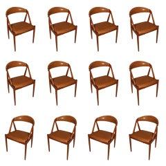 Set of 12 Teak dining chairs in caramel leather By Kai Kristiansen